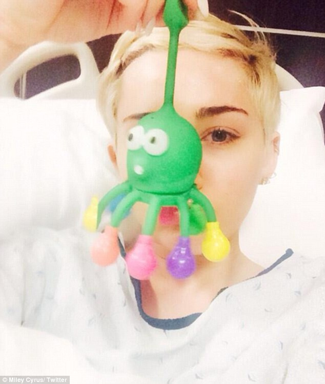 Getting some rest: Miley shared a photo via Twitter from her hospital bed on Tuesday after cancelling her Kansas City performance