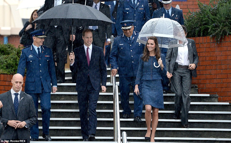 All smiles: Despite the unfortunate weather the Cambridges smiled broadly as they were greeted by crowds at the police college outside Wellington