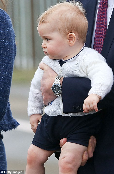 Wide awake: Prince George was alert and curious as he was held by his father as they made as the family prepared to leave New Zealand