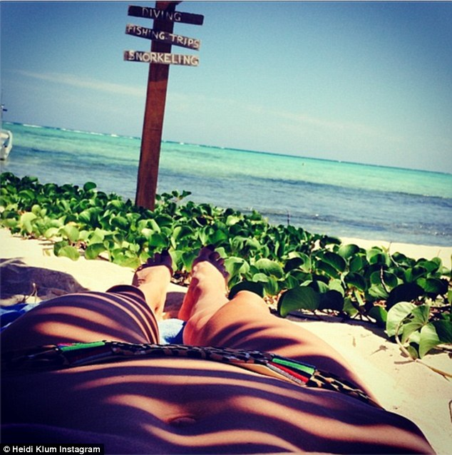 What a view: She shared this photo of her taut tummy and long pins with the message, 'beautiful day'