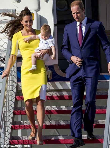The couple disembarked from the plane, with Kate carrying baby George dressed all in white