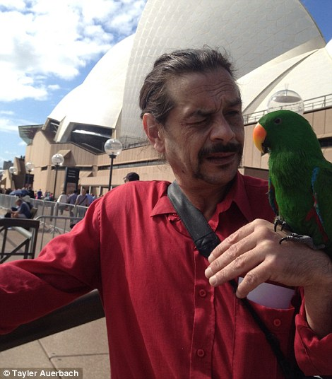Among the thousands of people lining the Sydney Harbour foreshore today is Pierre and his pet parrot Caesar.The Sydneysider hoped his colourful, and appropriately named, bird will attract the attention of the royals
