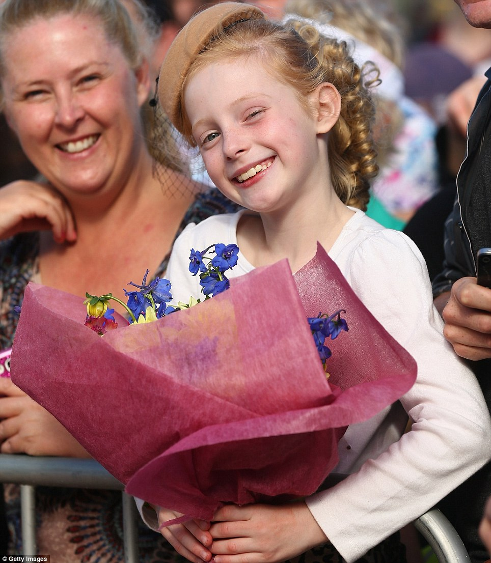 Sienna Miller, 8, of  Greystanes in Sydney's west has been waiting at the front of the barrier for hours in the hope of handing some flowers to the Duchess