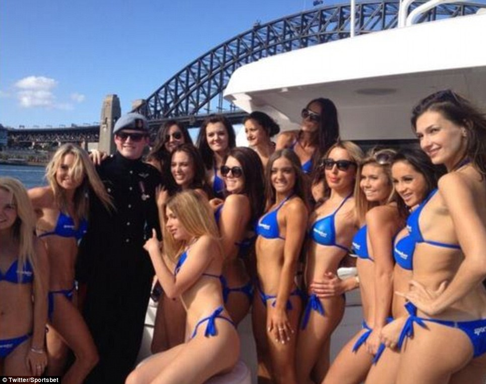 Cheeky: A Prince Harry look-alike on a 30ft yacht surprised the Royal arrival, but the boat - a prank by Sportsbet - was soon ushered from the area