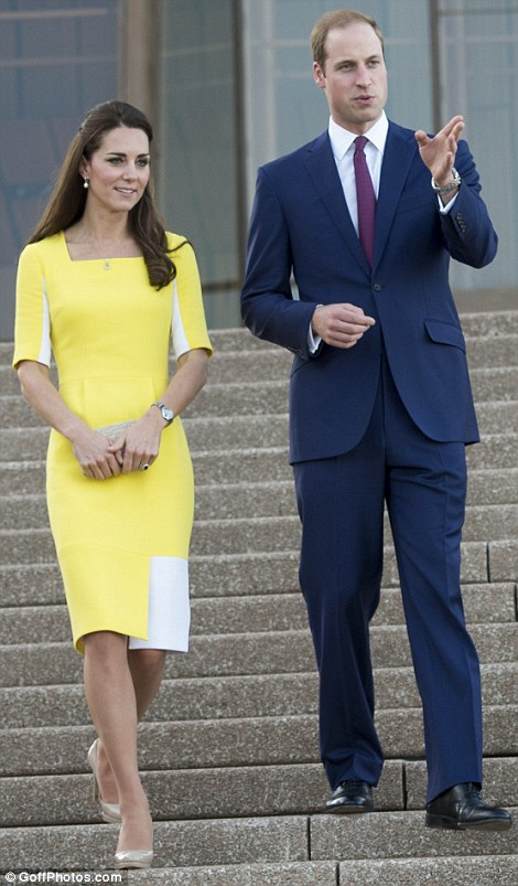 Tour guide: The Duchess listened intently as Prince William talked her through the major landmarks