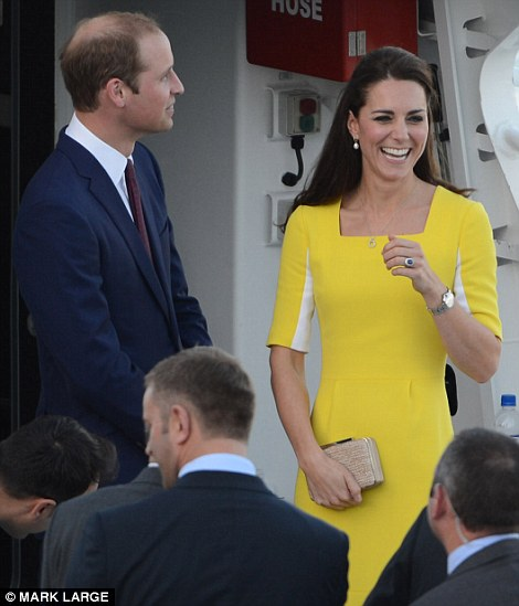 All smiles: The Duchess certainly appeared to be enjoying herself as she and Prince William cruised across the harbour