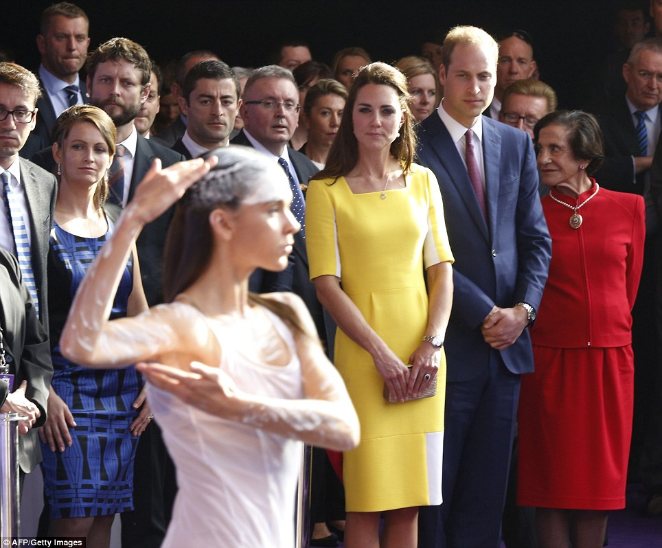 Welcome performance: The Duke and Duchess watched on intently as the dancers took the stage