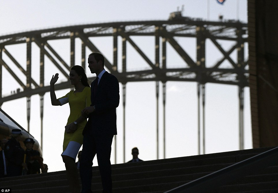 In the heart of the city: The Sydney Harbour Bridge could been seen in the background as the Royal couple descended the steps of the Opera House