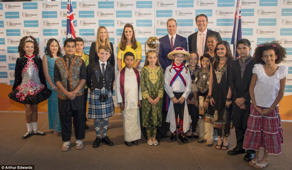 All around the world: The Royal couple then posed with Perry (left of Kate) and McGrath (right of William) as well as several schoolchildren representing the countries due to play in the 2015 Cricket World Cup