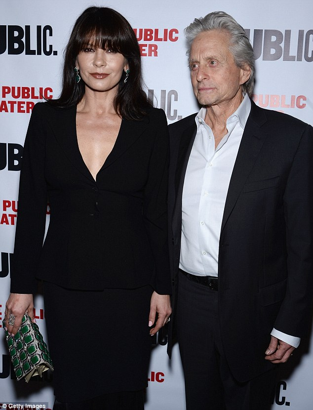 Looking good! Catherine Zeta-Jones and Michael Douglas opted for chic dark ensembles