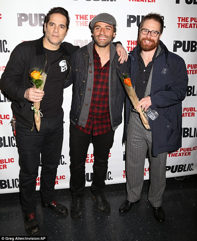 There they are! Yul Vazquez, Oscar Isaac, and Sam Rockwell grinned while holding flowers at the opening night of The Library