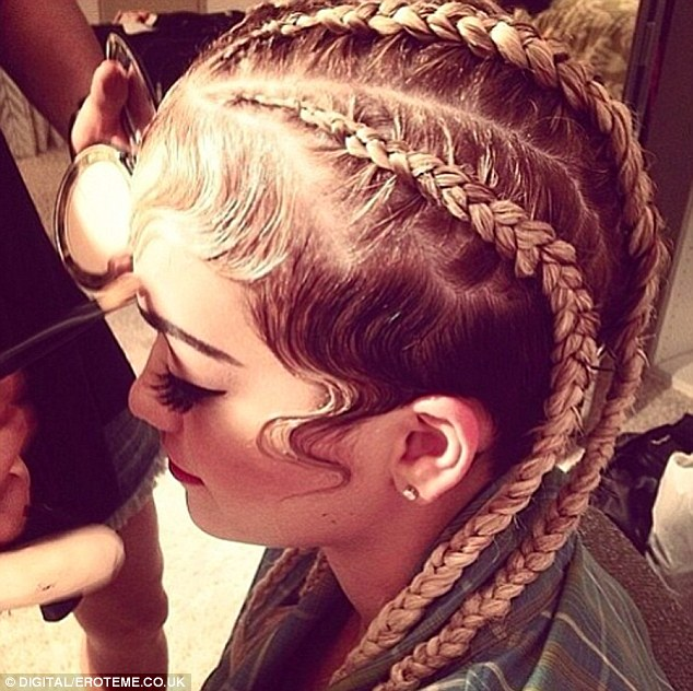 Street-style: The singer went for a more urban look, gelling curls to her face and giving herself corn rows