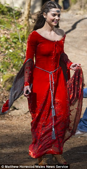 Suits her: Jenna certainly looked the fair maiden in the red dress