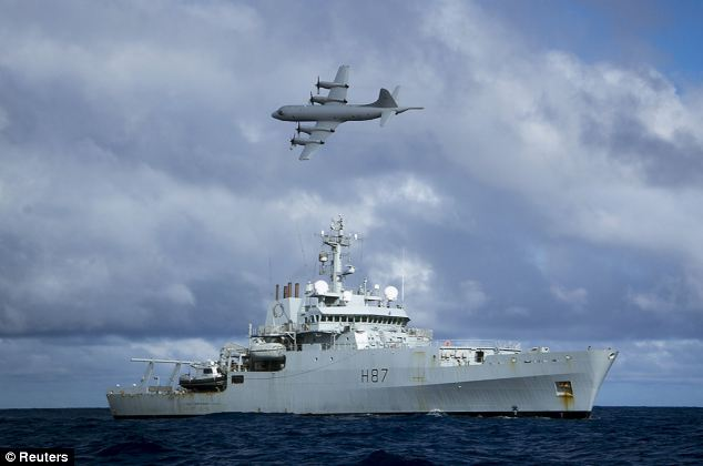 A Royal Australian Air Force (RAAF) AP-3C Orion aircraft flies past the British naval ship HMS Echo in the southern Indian Ocean as they continue to search for the missing Malaysia Airlines flight MH370 on Tuesday