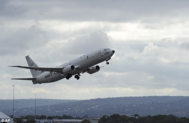 A U.S. Navy P-8 Poseidon aircraft flies out from Perth Airport, in Australia, on Wednesday to assist in the search for the missing plane