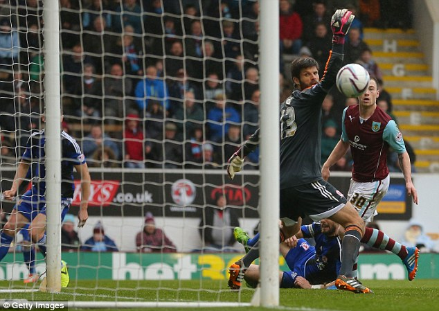 Flicked wide: Konstantopoulos makes a save from Burnley's Ashley Barnes in their recent game at Turf Moor
