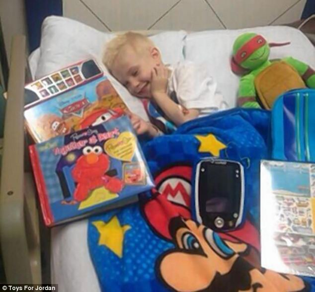 On the mend: A smiling Jordan is pictured in hospital after receiving gifts from strangers