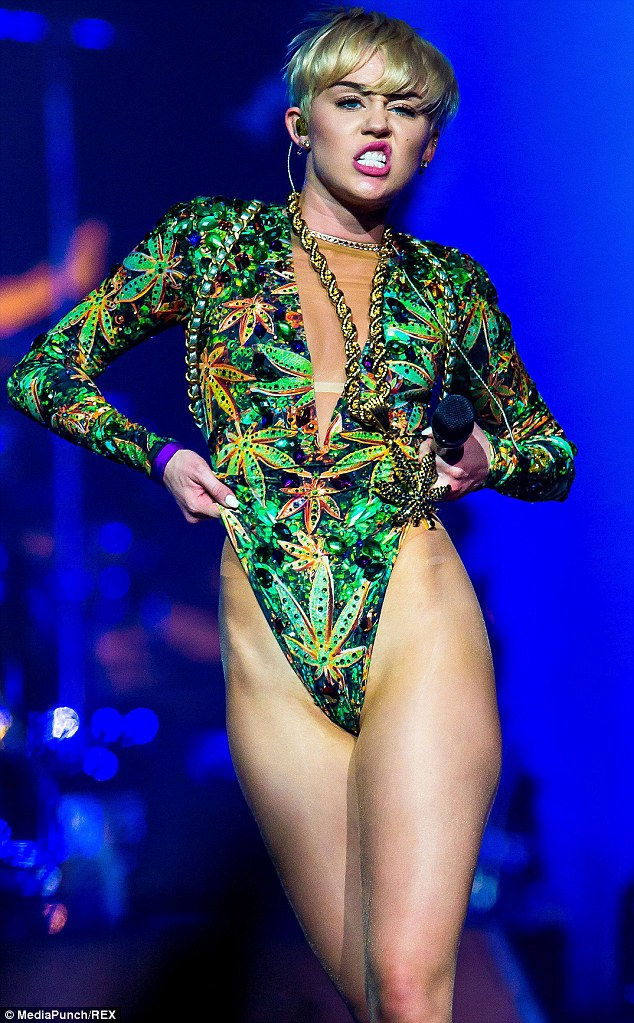 She loves to smoke: Cyrus, in a marijuana print costume for her Saturday concert in Auburn Hills, may be hurting her heart even more with all the drugs she has admitted she likes to do