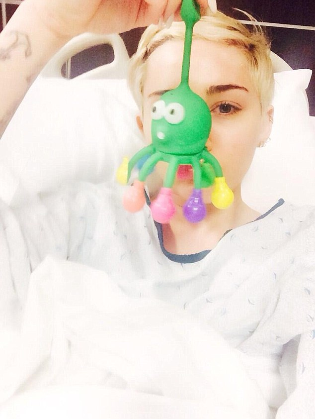 Fallen ill: The 21-year-old singer shared a photo of herself in a hospital bed Tuesday