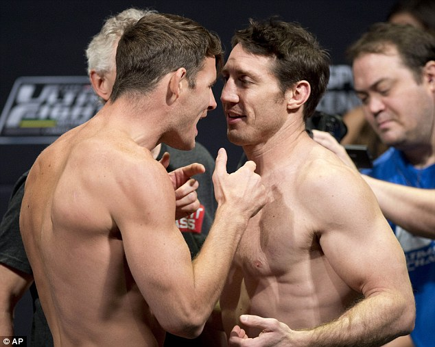 Square up: Middleweight Michael Bisping (left) has banter with American Tim Kennedy at the weigh-in