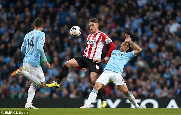 Control: Sunderland's Connor Wickham brings down the ball under pressure from Martin Demichelis