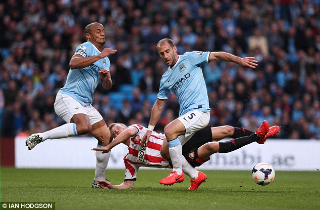 Collision: Sebastian Larsson hits Vincent Kompany's knee after being dispossessed