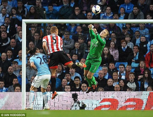 Acrobat: Joe Hart flies through the air to punch away a Sunderland corner