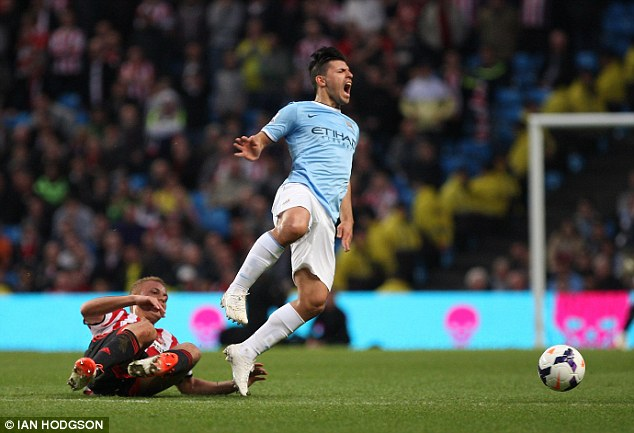 Late: Wes Brown makes a late challenge on Aguero