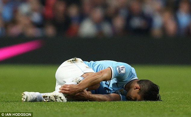 In a heap: The Argentine striker was left hurt following the tackle