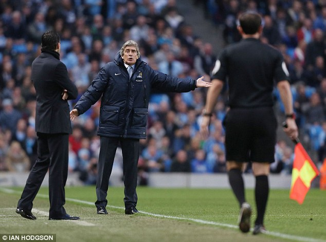 Frustrated: Manuel Pellegrini speaks to the assistant referee
