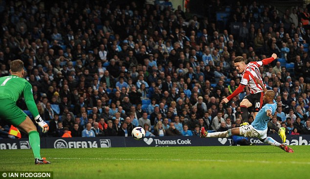 Double: Wickham fires home his second goal as City almost threw it away