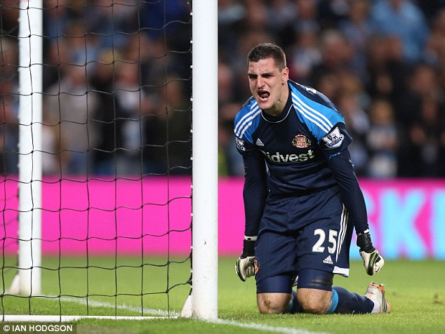 Angry: Mannone reacts after conceding the soft equaliser