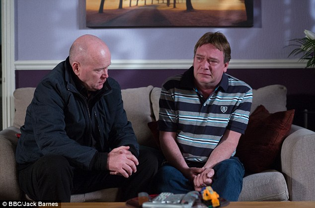 Emotional: Ian, played by long-serving cast-memner Adam Woodyatt, shares a moment with Phil