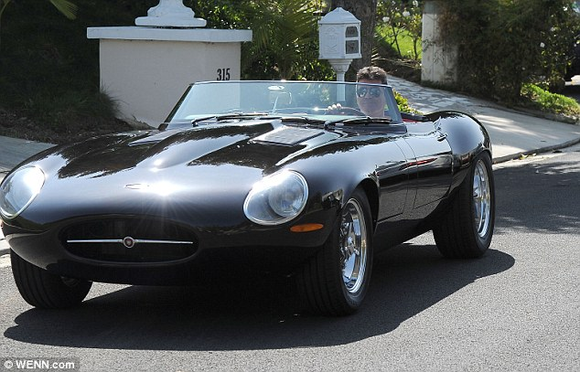 He's a speed machine: Simon took his £650,000 Jaguar E-type recreation out for a spin after lunch