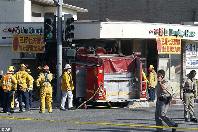 Meal interrupted: The crash sent one of the fire trucks straight into a Chinese restaurant