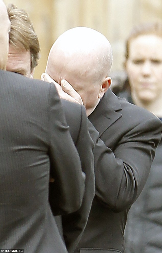 It's all too much: The 55-year-old actor wept into his hand after filming the emotional funeral scenes