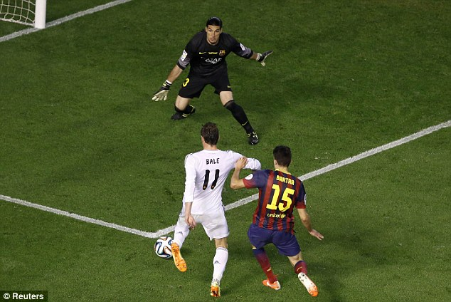 Set up: Bale prepares to slip the ball between Jose Pinto's legs