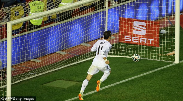 Winner: Bale wheels off to celebrate in front of the fans at the Mestalla