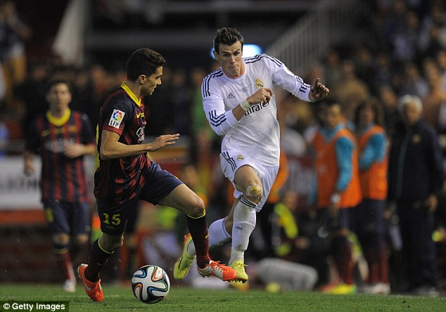 Speed: Bale beats Marc Bartra after receiving the ball near the halfway line