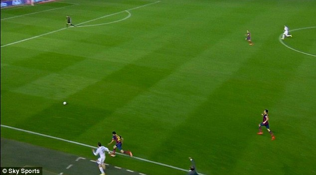 Level pegging: Bale was alongside with Bartra 20 yards into Barca's half despite going off the pitch