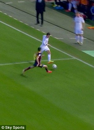 Slipped: Bale knocks the ball beyond Bartra