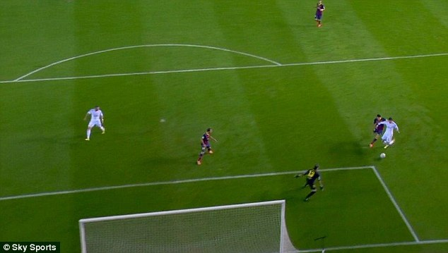 Keeping his cool: Bale prepares to slide the ball past Pinto and into the net
