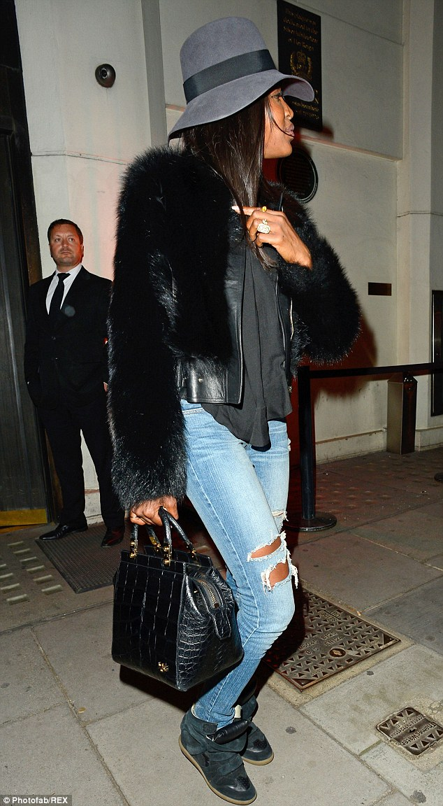 Back to her roots: Naomi, 43, looked typically well-groomed in a wide-brimmed felt hat when out and about in London