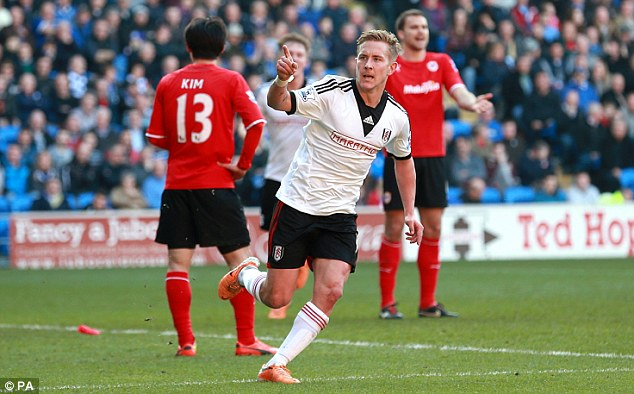 Loan star: Holtby has impressed while on loan at Fulham this term as he celebrates a goal against Cardiff