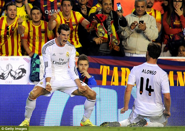 Centre of attention: Gareth Bale (left) celebrates scoring with Real Madrid team-mate Xabi Alonso in Wednesday's Copa del Rey final victory over Barcelona