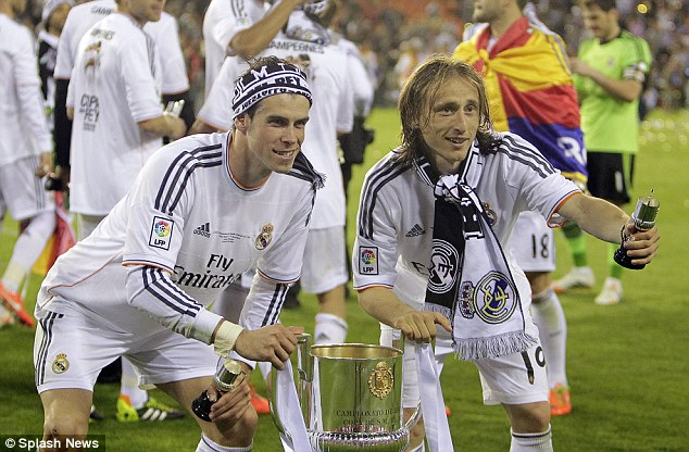 Winners: Bale and team-mate Luka Modric pose with the Copa del Rey trophy after beating Barcelona