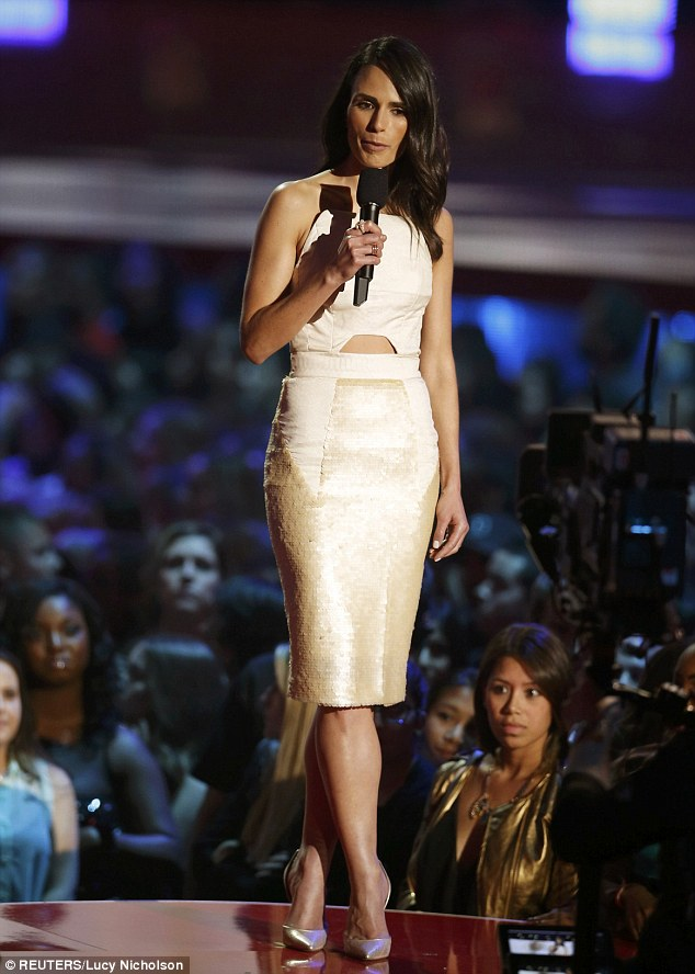 Lovely: While presenting, the brunette beauty looked elegant in a cut-out Fyodor Golan dress and matching Henri Lepore Dezert pumps