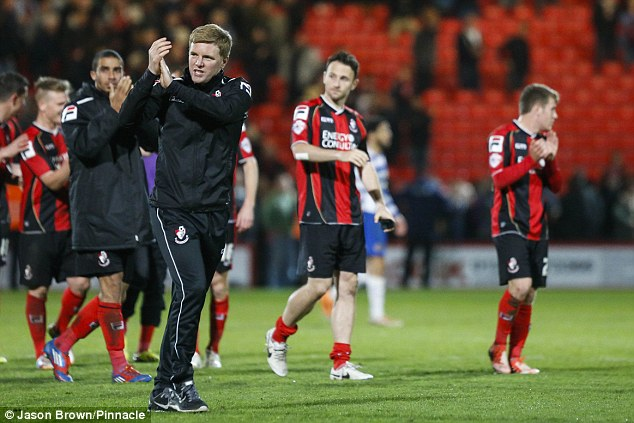 Form team: Eddie Howe and his players applaud the Bournemouth fans after beating Reading earlier this month