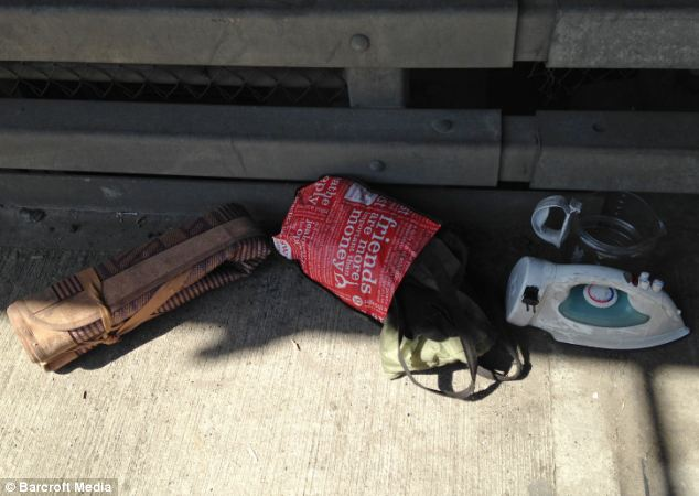 Stash: The team of police officers pulled down his belongings on Thursday, including electrical items