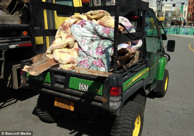 Belongings: They pulled down his belongings and piled them high in trucks to be discarded